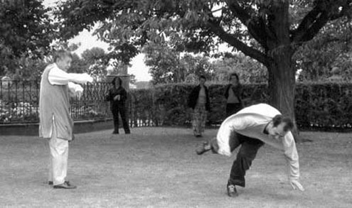 Dr. Shen Hangxun and a student perform an exercise without touching